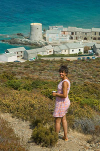 Photo of Marie Antoinette walking down a hill toward the quaint little village of Tolare.