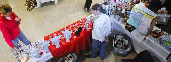 Photo of Marie Gilvey greeting customers at booth.