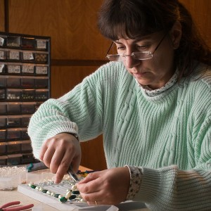 Photo of Marie Antoinette Gilvey making new bead jewelry